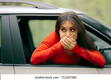 Car Sick Woman Having Motion Sickness Symptoms - Suffering girl in a pulled over automobile trying to recover from travel sickness
