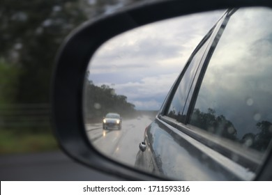 car side mirror view rainy day