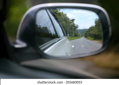 Car side mirror when driving show straight road