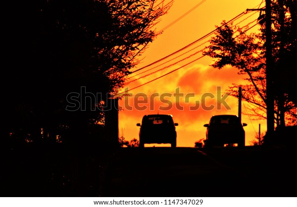 Car silhouette of a sunset