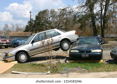 Car sits on another car after being lifted by Hurricane Katrina. Taken on Keesler AFB, MS on September 8, 2005.