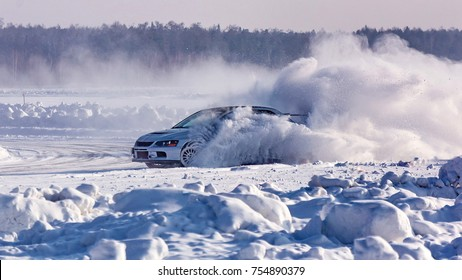 The car skidded on a snow-covered winter road. Emergency braking. Racing on the ice of the lake.