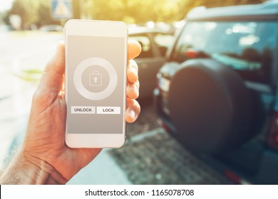 Car smartphone app for vehicle lock and unlock, man holding mobile phone in hand