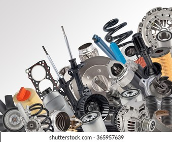 Lot of car spare parts on white