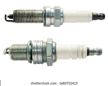 Car spark plug isolated on a white background. Close up. Selective focus
