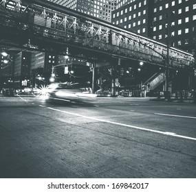 Car speeding in Lower Manhattan. Vintage black and white processed