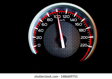 Car speedometer dashboard show speed 100 kilometer per hour.