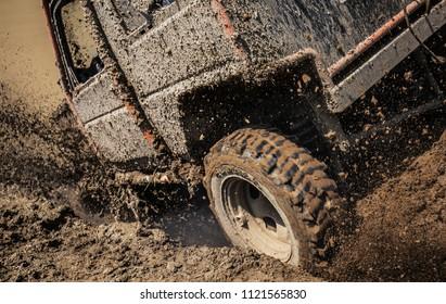 Car splashing in muddy terrain