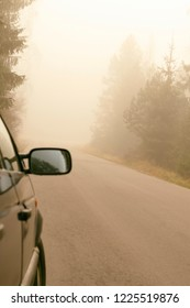 the car stands apart. the road, there is a natural fog. road swallowed. there is toning