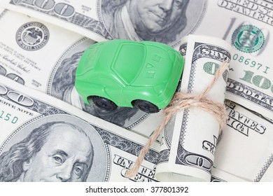 Car stands on dollar banknotes. cost of buying a car, fuel, insurance and other car costs