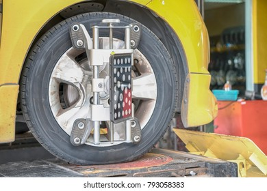 Car Steering Wheel Balancer Calibrate with laser reflector attach on each tire to center driving adjust.