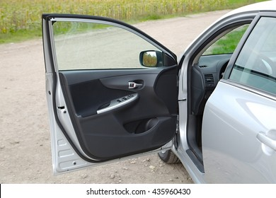 Car stopped with open door