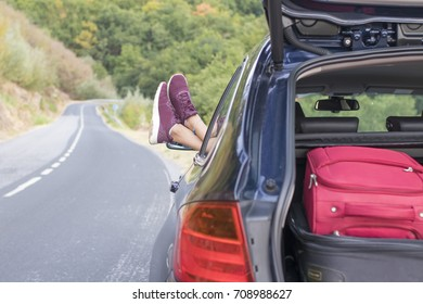 car with suitcases and driver resting
