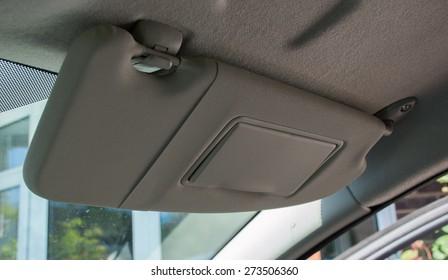 Car sun visor in the down position