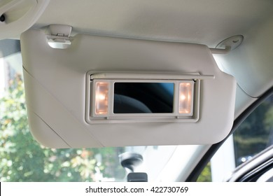 Car sun visor with illuminated mirror