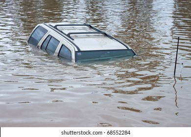 Car swamped in flood water.  Perfect for motor vehicle insurance theme.