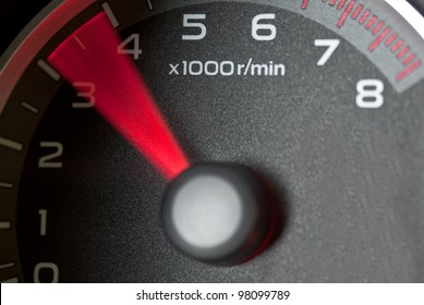 Car tachometer with moving needle