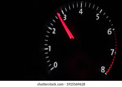 Car tachometer on a black background. race. Engine speed