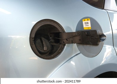 car tank ready to be fuel up in gas station