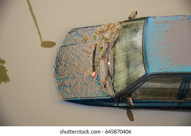 A car that was destroyed in a pole after the hurricane.