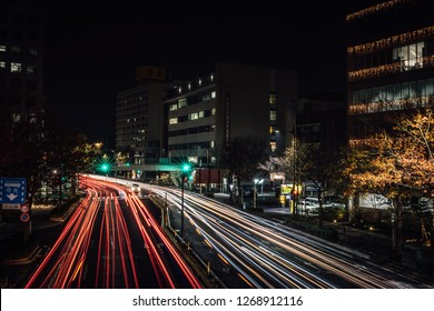 car that is moving with blurred light all over the city at night.