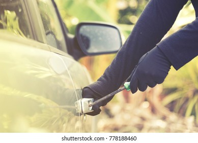 Car thief steal robber stolen secure. Crime carjacking stealing vehicle at danger  car parking. Thieves try to breaking window door vandalism looting. Transportation Insurance protect car park person.
