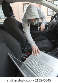 car thief stealing a laptop