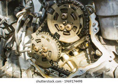 Car timing chain in cutaway engine. vct