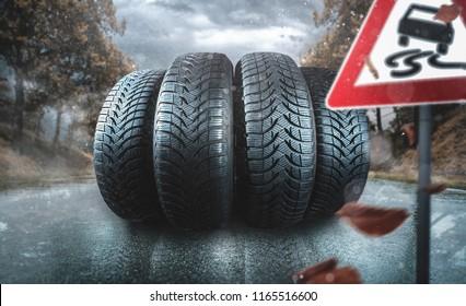Car tire on an autumn road
