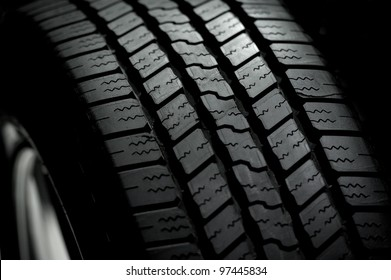 Car Tire on Black Background. Car Tire in the Dark - Spot Light