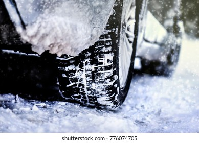 Car tire on winter road, Tires on snow, Close up of  car tire in winter