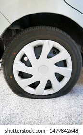 Car tire puncture on the road