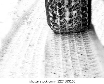 Car tire in snow on slick icy road tread travel vehicle