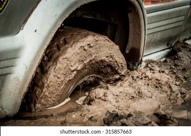 car tire stuck in the mud