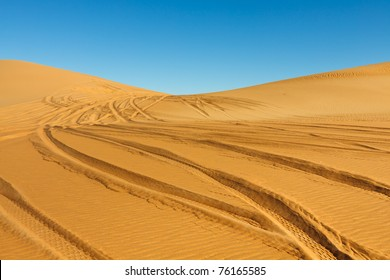 Car tire tracks in the desert - Awbari Sand Sea, Sahara, Libya