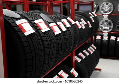 Car tires in automobile store, closeup