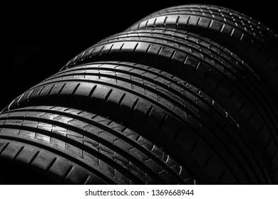 Car tires on dark background, closeup