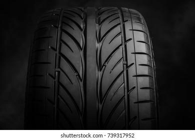 Car tires on a dark background. Summer car tires.