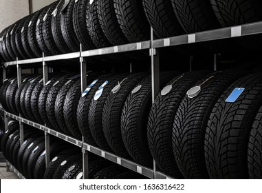 Car tires on rack in auto store