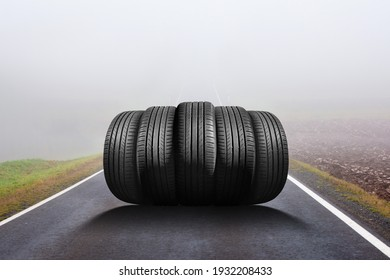 car tires on the road in the fog - time for summer tires