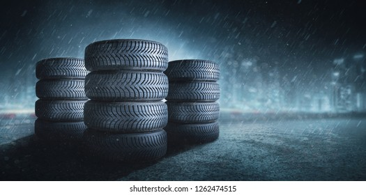 Car tires on wet roadway