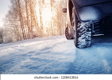 Car tires on winter road covered with snow. Snowy landscape with a vehicle