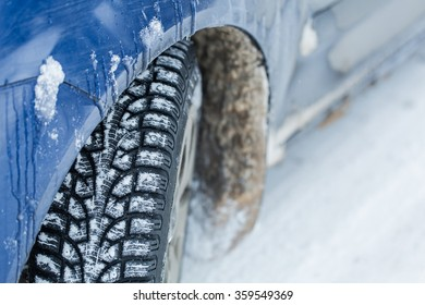 Car tires on winter road.