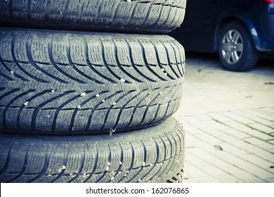 car tires prepared to replace in a garage