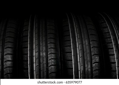 Car tires in row isolated on black background