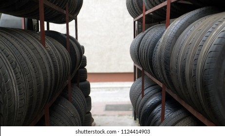 car tires in a row for sale at booth in store
