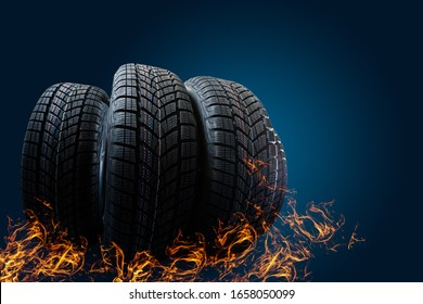 Car tires stand on a road