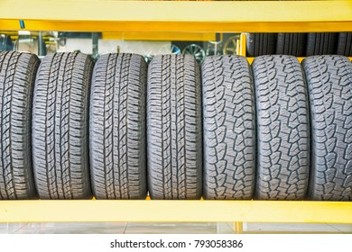 Car tires at warehouse in tire store.
