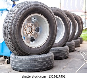 Car tires and wheels showing for sell or repair in the shop.