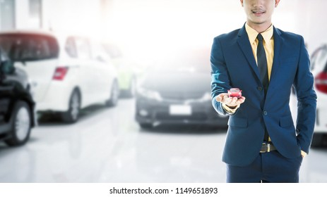 car toy on business man hand.Car insurance. Automobile collision damage waiver concepts. with protective gesture and of car. Protection of car. Business concept.